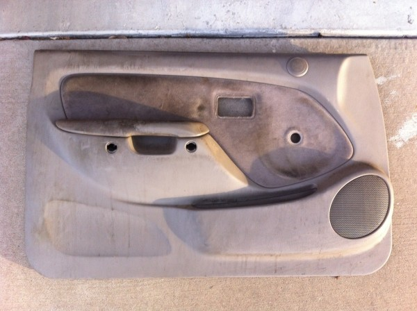 Driver's side door panel removed.  14 years of dirt and gunk. Messy.