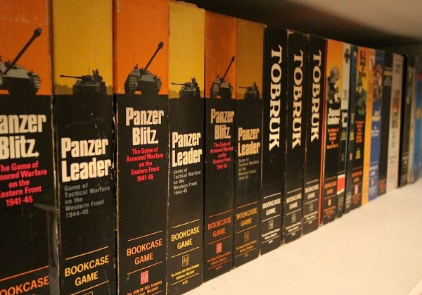 Wide-angle lens practice on a shelf of old Avalon Hill games.