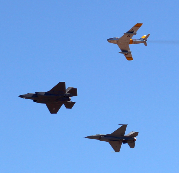 An F-86 Sabre, F-22 Raptor, and F-16 Falcon roam the morning skies above the PIMA museum.