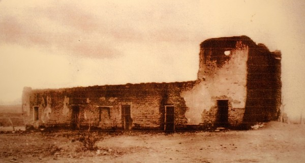 A photo of an old photo of the Tubac presidio north wall.