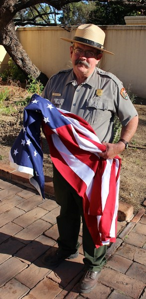 Rick Collins, park ranger and Anza enthusiast, lets me interrupt his day-end flag duties for a photo. Tumacácori National Historical Park.