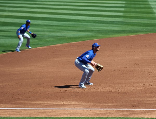 Addison Russell and Kris Bryant react to a pitch.