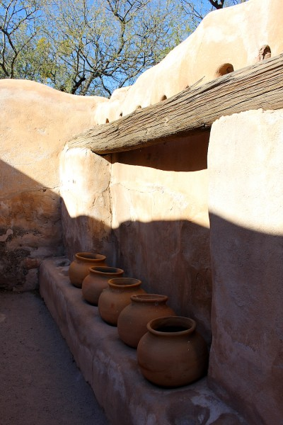 Pots on a storehouse wall.